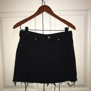 Black denim distressed skirt